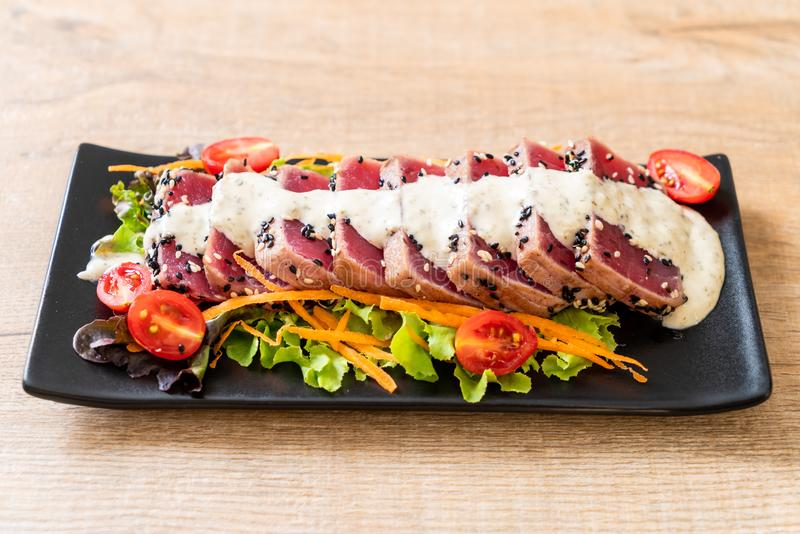 fresh tuna raw with vegetable salad and sauce royalty free stock images