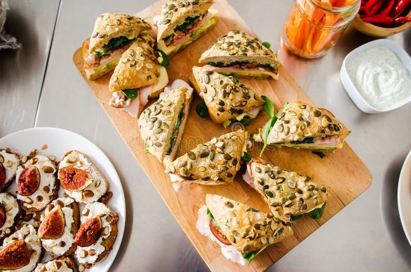 Fresh turkey ham and avocado sandwich. Fresh sandwich with turkey ham, avocado and cheese royalty free stock images