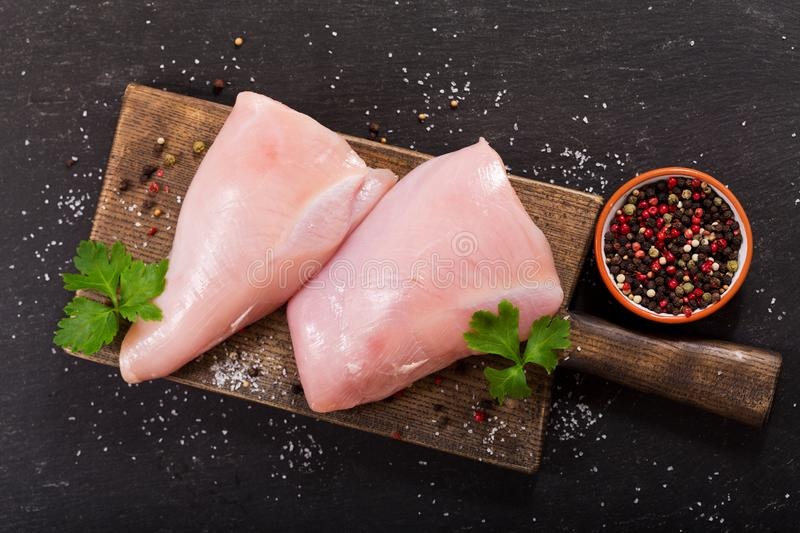 Fresh turkey meat on dark table royalty free stock images