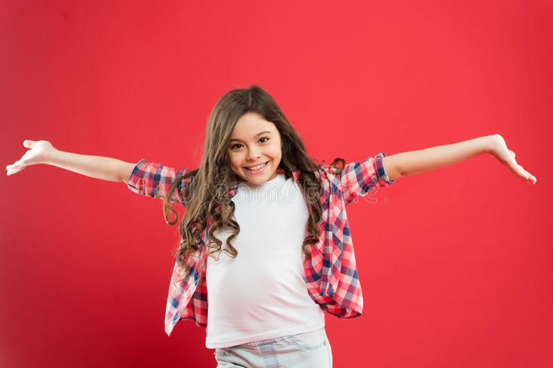 Fresh it up. Nice and tidy hairstyle. Small child long hair. Girl active kid with long hair. Dry shampoo. Easy tips. Making hairstyle for kids. Strong and stock photo