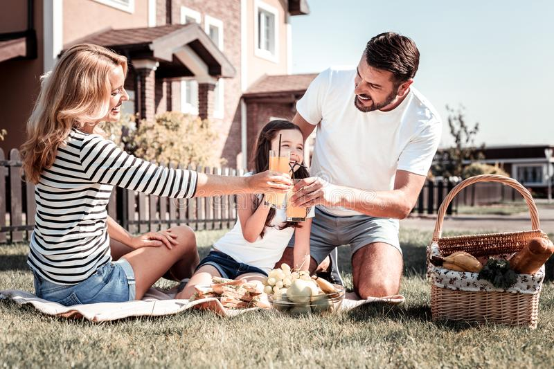 Cute happy family spending time together having a picnic. royalty free stock image