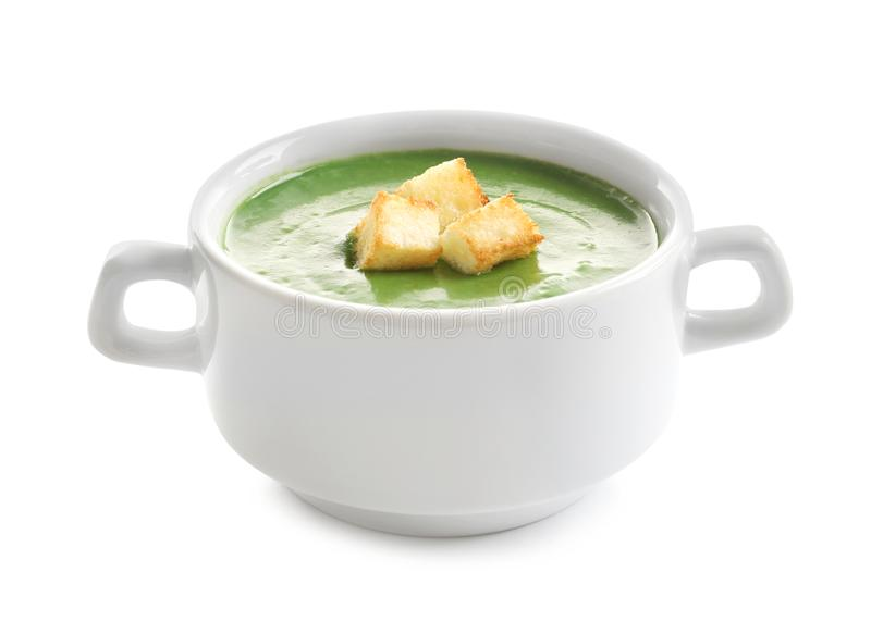 Fresh vegetable detox soup with croutons in dish. On white background stock images