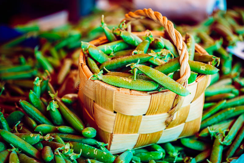 Fresh Vegetable Organic Green Beans In Decorative Wicker Basket. royalty free stock images