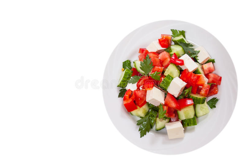 Fresh vegetable salad with cheese. top view. isolated royalty free stock photo