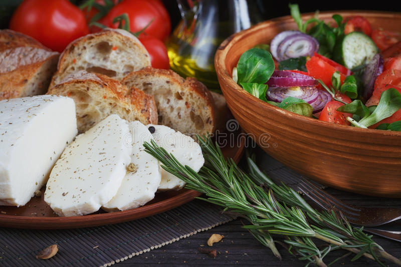 Fresh vegetable salad with tomatoes, cucumbers and onions. stock photo