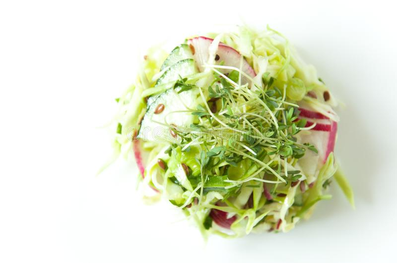 Fresh vegetable salad on a white plate. Beautiful serving dishes. Dietary nutrition. Vegan food. Microgreen, flax seeds in food. W stock photos