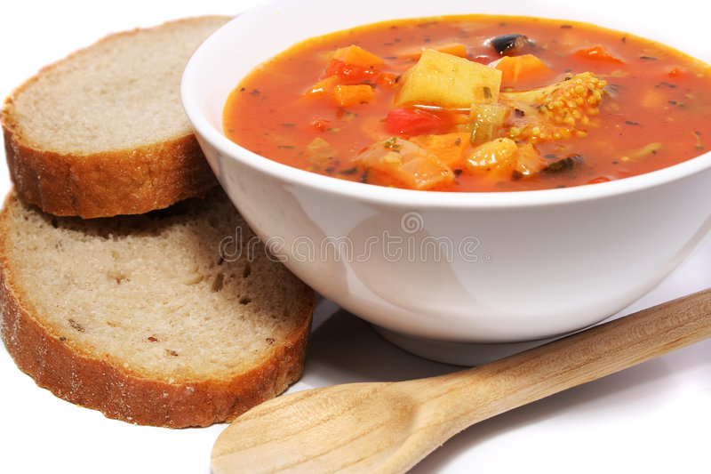 Fresh vegetable soup. With bread stock photo
