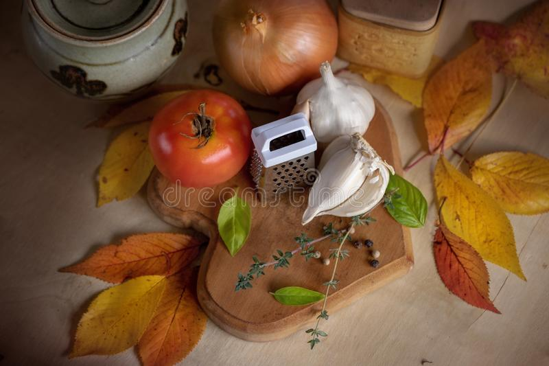 Fresh vegetable soup ingredients autumn leaves wooden table royalty free stock photography