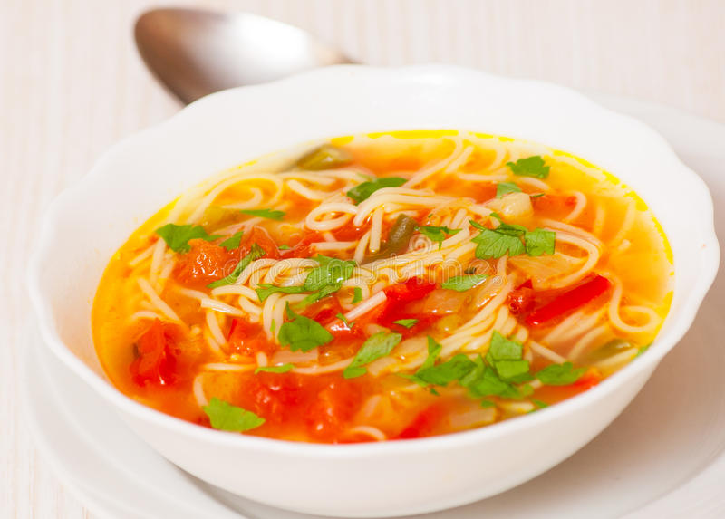 Fresh vegetable soup with noodles stock photo