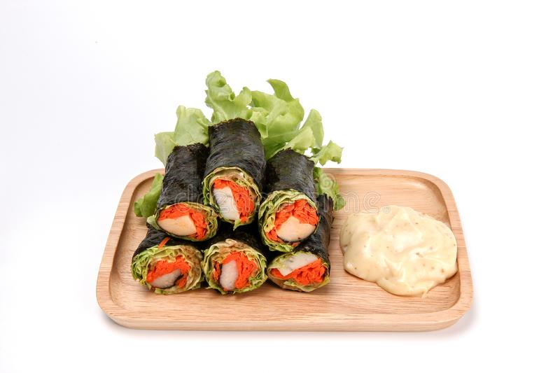 Fresh vegetable spring roll, salad roll in Seaweed tube on ceramic plate, clean food, salad for weight loss. Fresh vegetable spring roll, salad roll in Seaweed royalty free stock images
