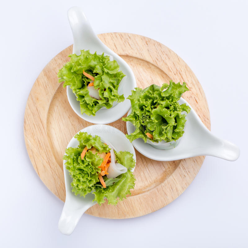 Fresh vegetable spring roll served by canape spoon, Thai or Vietnamese appetizer healthy dish. stock photo