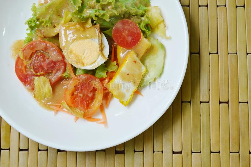 Fresh vegetable topping boiled egg dressing Indian sauce salad on plate. Fresh vegetable topping boiled egg dressing Indian sauce salad on white plate royalty free stock image