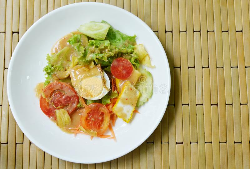 Fresh vegetable topping boiled egg dressing Indian sauce salad on plate. Fresh vegetable topping boiled egg dressing Indian sauce salad on white plate royalty free stock photography