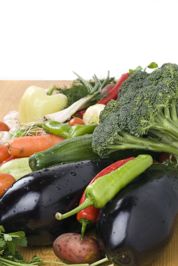 Pile of Fresh Vegetables on Cutting Board stock photography