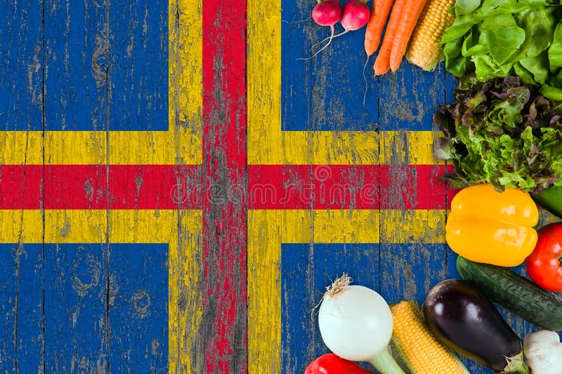 Fresh vegetables from Aland Islands on table. Cooking concept on wooden flag background.  stock image