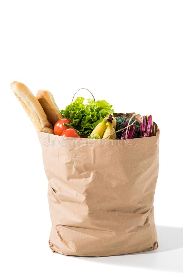 fresh vegetables, baguettes and bananas in grocery bag stock photos