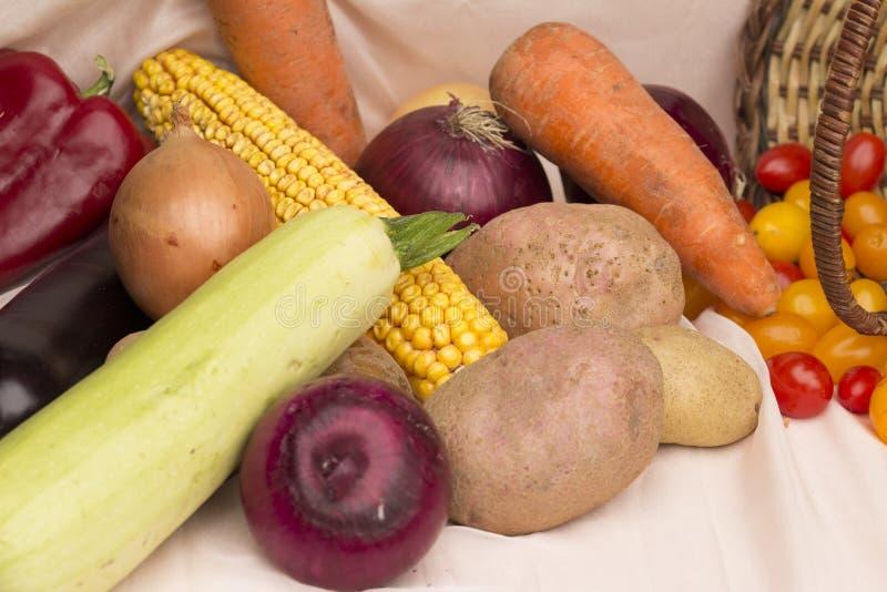 Fresh vegetables in basket on grass background. harvest festival concept.  stock photo