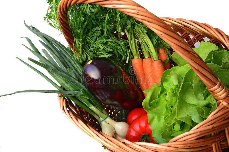 Fresh vegetables in a basket royalty free stock image