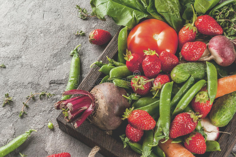 Fresh vegetables, berries, greens and fruits in tray royalty free stock image