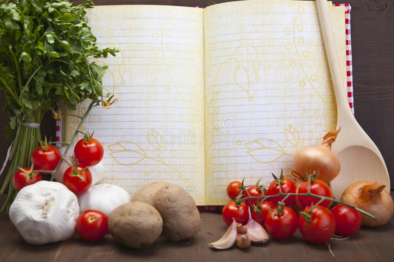 Fresh vegetables and book stock photos