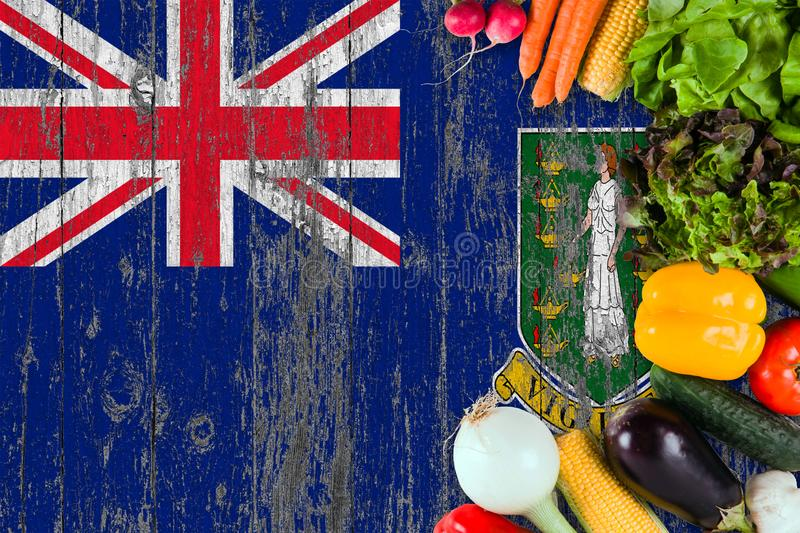 Fresh vegetables from British Virgin Islands on table. Cooking concept on wooden flag background stock image