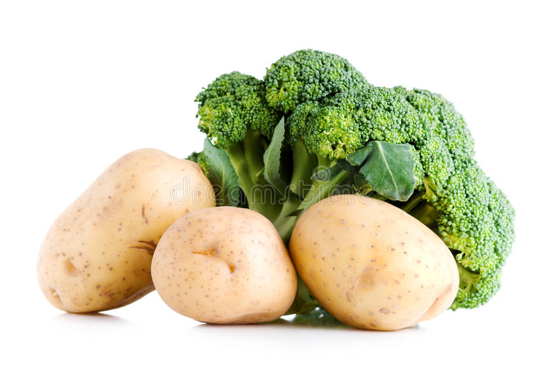 Fresh vegetables, broccoli and potatoes. On white royalty free stock image