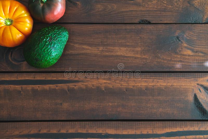 Fresh vegetables on a brown wooden table. royalty free stock photos