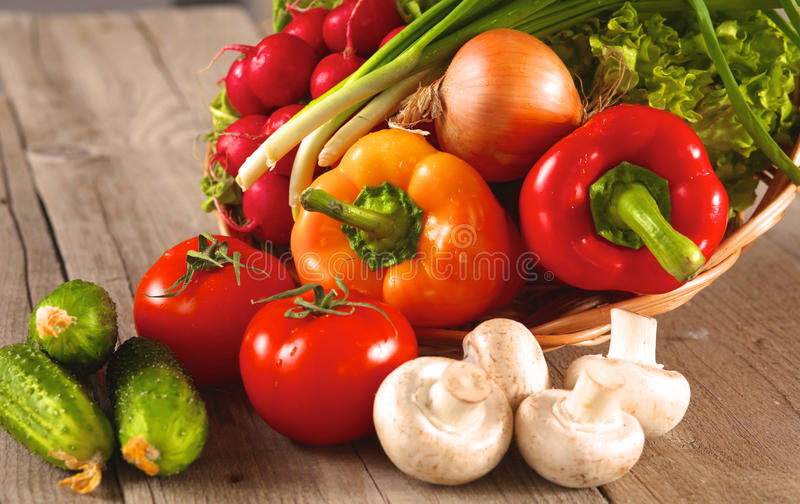 Fresh vegetables on a clean wooden table.  stock image