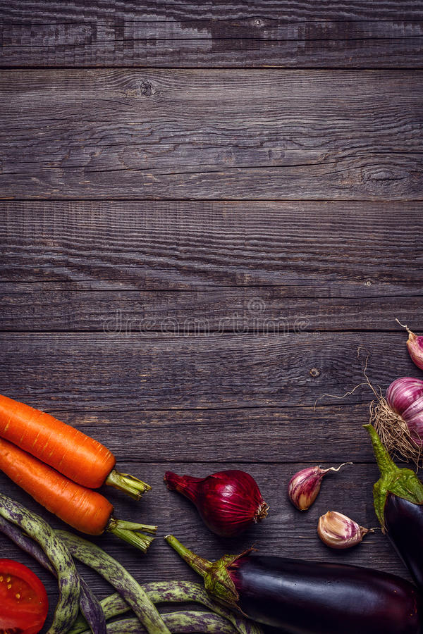 Fresh vegetables for cooking on dark wooden background royalty free stock images