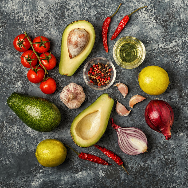 Fresh vegetables for cooking on dark wooden background. stock photos