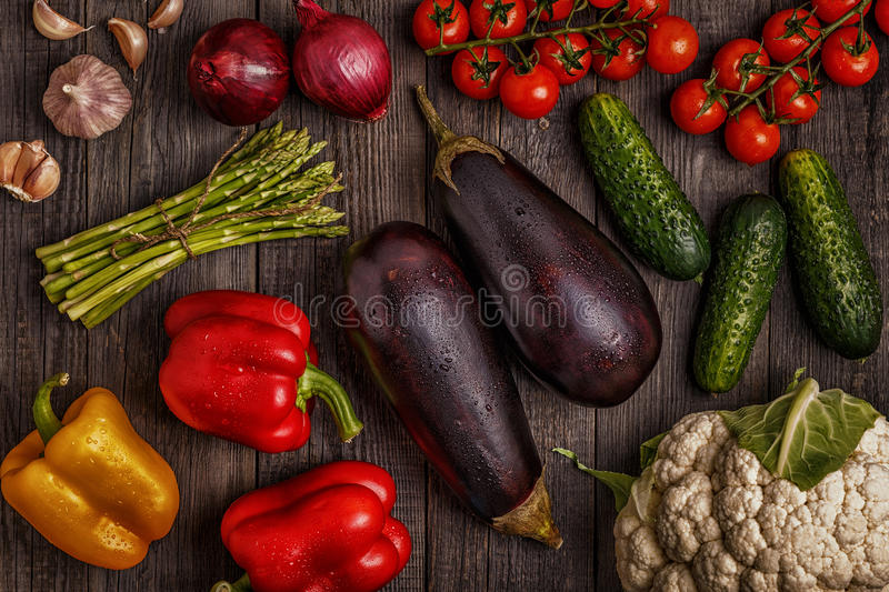 Fresh vegetables for cooking on dark wooden background. stock photography