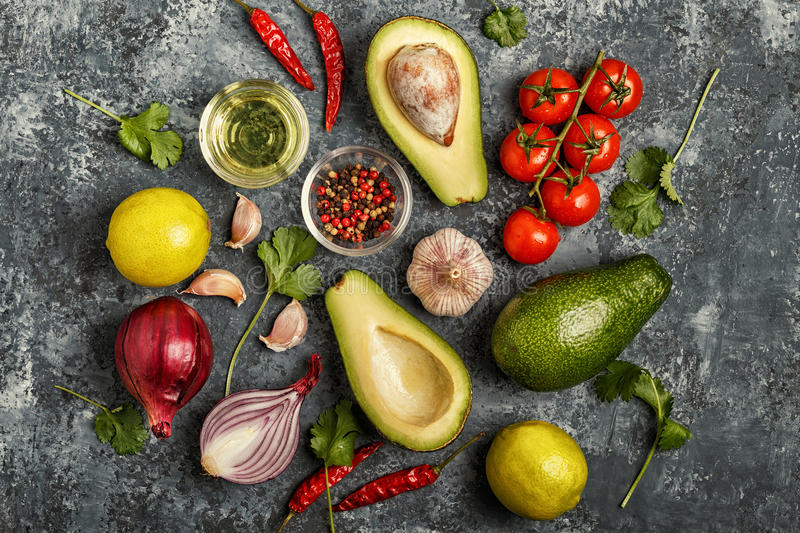 Fresh vegetables for cooking on dark wooden background. stock image