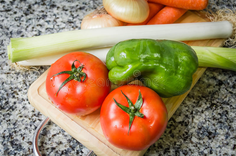 Fresh vegetables on cutting board in the kitchen stock photos
