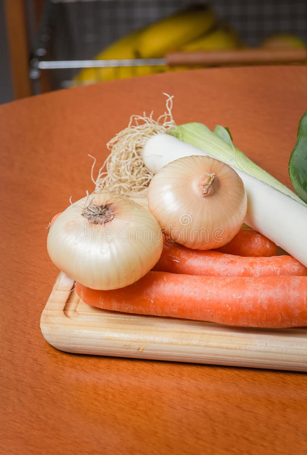 Fresh vegetables on cutting board in the kitchen stock photo