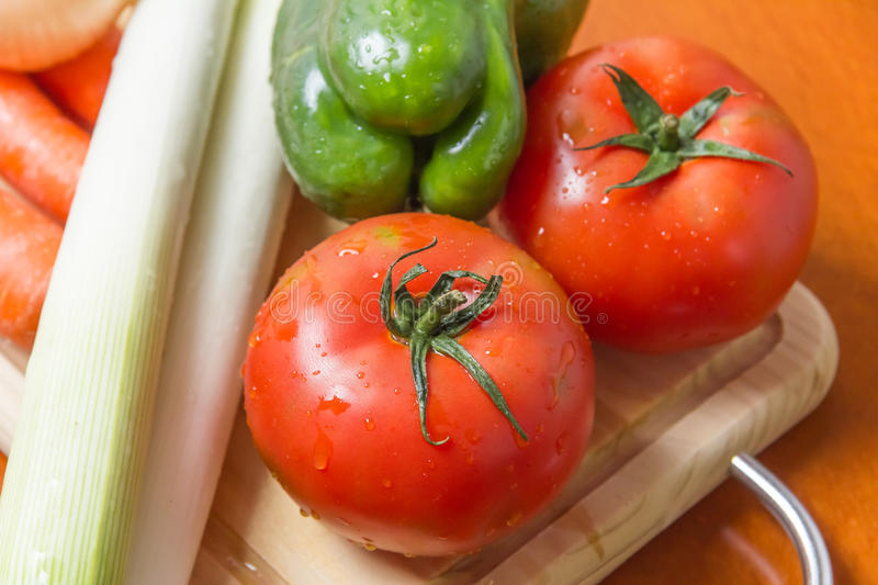 Fresh vegetables on cutting board in the kitchen royalty free stock photo