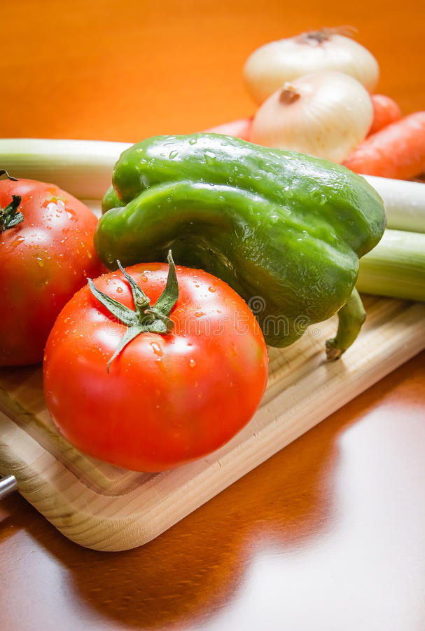 Fresh vegetables on cutting board in the kitchen stock image