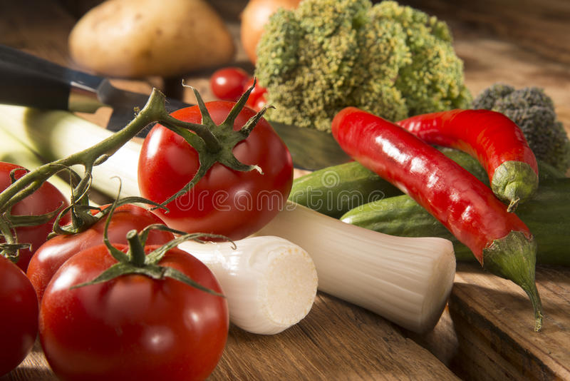 Fresh vegetables on a cutting board royalty free stock images