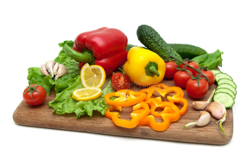 Fresh vegetables on a cutting board on a white background. Horizontal photo stock photos