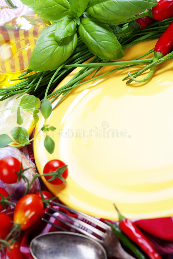 Fresh vegetables and empty plate (for your text)