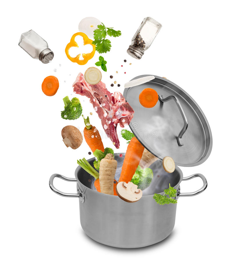 Fresh vegetables falling into stainless steel pot royalty free stock images