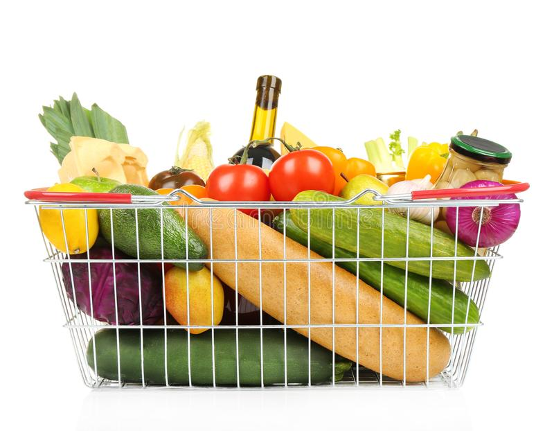 Fresh vegetables and foodstuff in shopping basket. On white background royalty free stock image