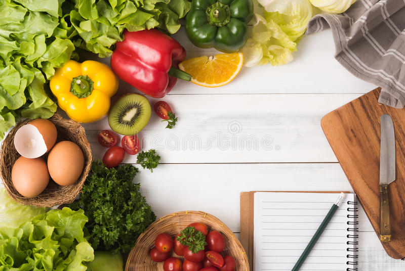 Fresh vegetables and fruit on wood background, healthy food royalty free stock photos