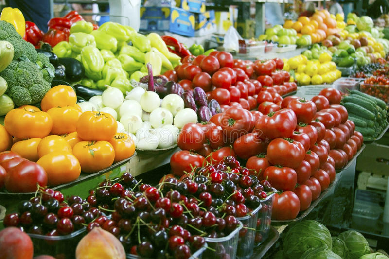 Fresh vegetables and fruits on farmer agricultural market royalty free stock images