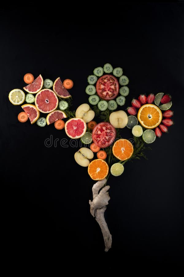 Fresh vegetables and fruits, a vegan bouquet. Full of fresh vegetables and fresh fruits, lemons, tomatoes, apples, oranges, cucumbers, lime, strawberries and royalty free stock photo