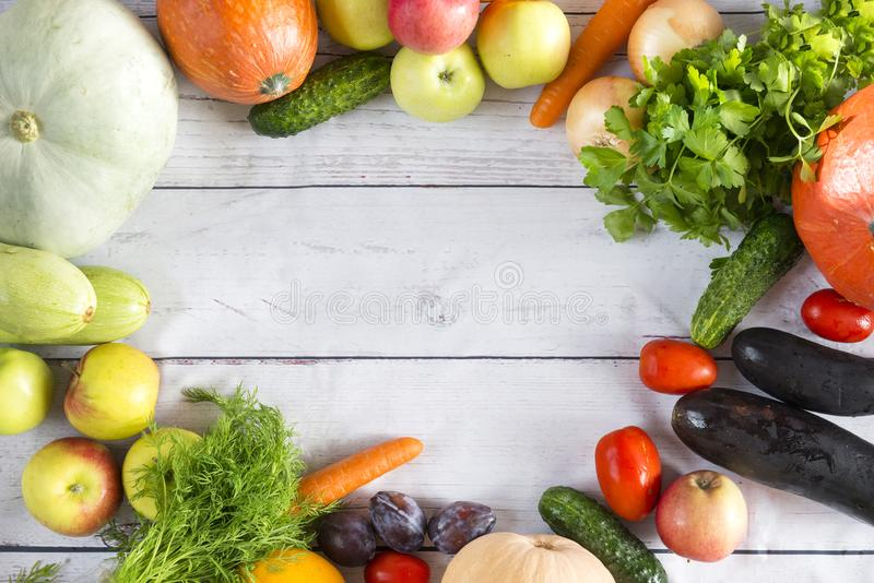 Fresh vegetables, fruits on wooden background, pumpkins, zucchini, carrots, cucumbers, plums, greens, healthy food, dill, parsley. Fresh vegetables, healthy food stock photography
