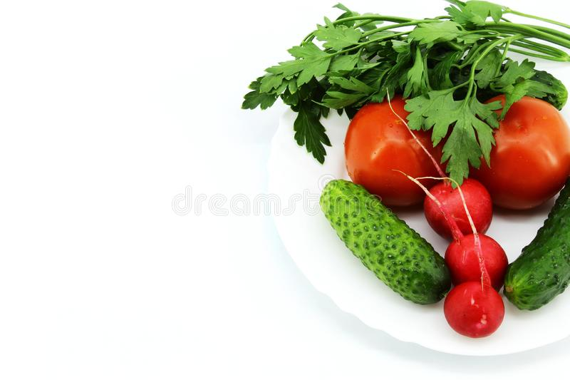 Fresh vegetables from the garden on a white round plate stock photography