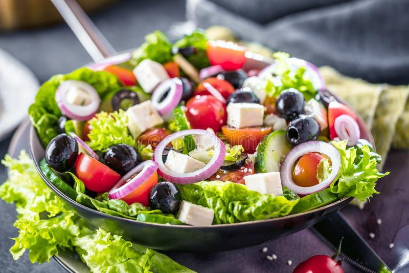 Fresh vegetables greek salad . Healthy food on wooden background. Fresh vegetables greek salad . Healthy food on wooden background stock images