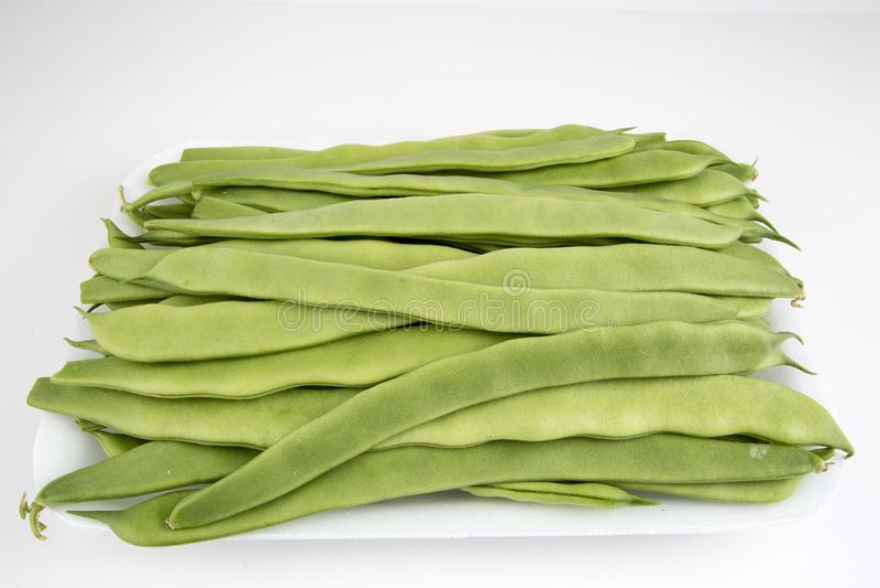 Fresh vegetables, green bean on the white background. stock photos