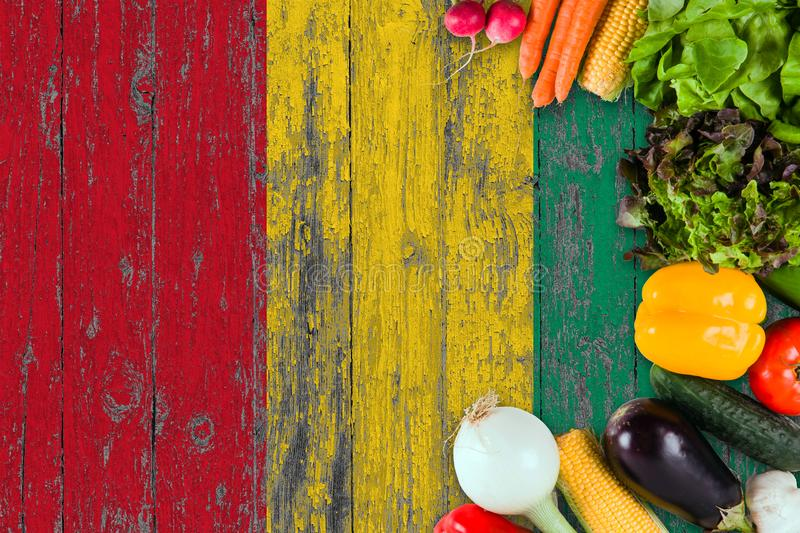Fresh vegetables from Guinea on table. Cooking concept on wooden flag background stock image