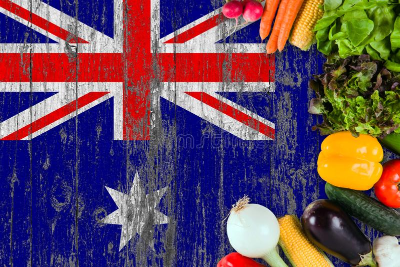 Fresh vegetables from Heard Island on table. Cooking concept on wooden flag background stock image